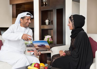Lifestyle Photographer - Arabic Couple In Suite Living Room
